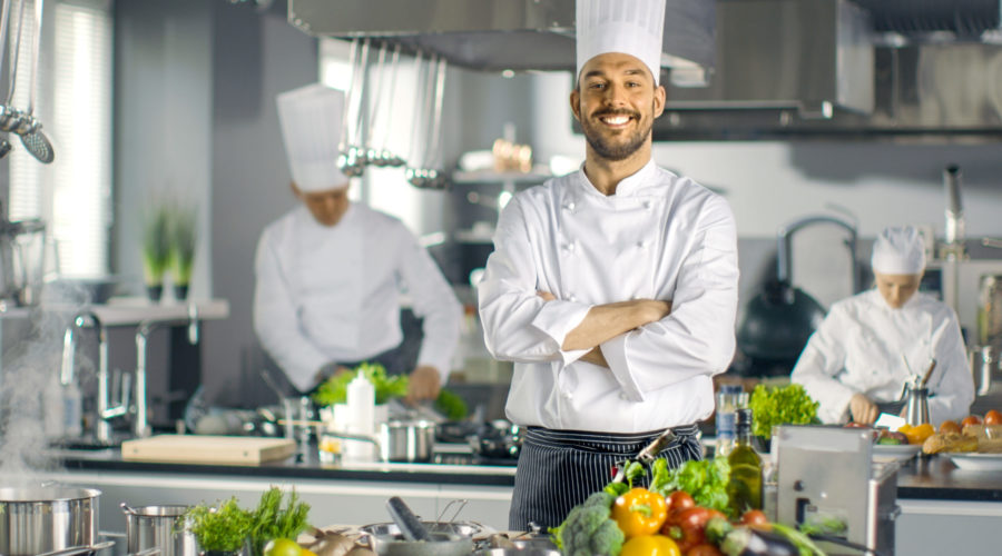 Famous,Chef,Of,A,Big,Restaurant,Crosses,Arms,And,Smiles
